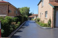REVITALIZED COLOURED SEALED DRIVEWAYS